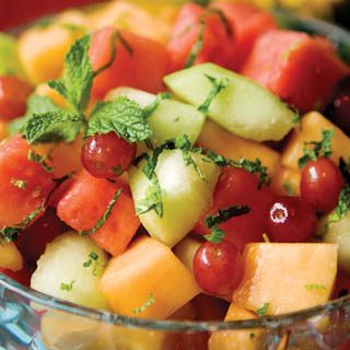 ... with a flavorful honey-lime-mint dressing for a sweet fruit salad