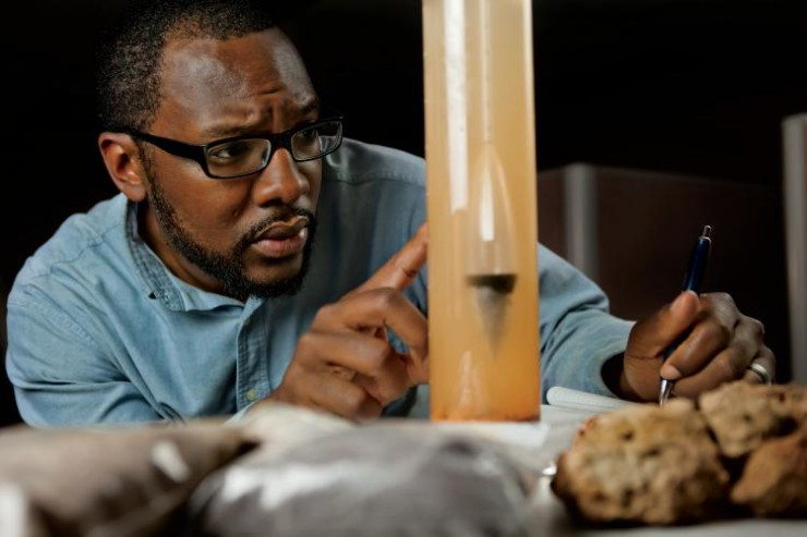 Soil Scientist determines the soil texture and particle size distribution using a soil hydrometer