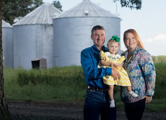 Jarrett Gurley with daughter Kemmer at their farm in Biscoe, Arkansas.