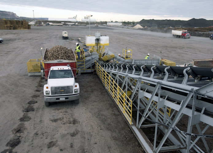 Truck loads of sugar beets arrive at the Western Sugar Cooperative facility in Scottsbluff, Nebraska