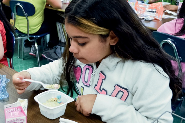 Lafayette Elementary School – fourth grader eating breakfast in the classroom